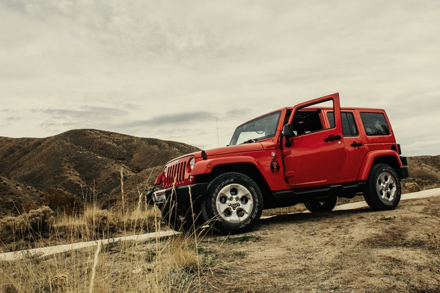 Red jeep on a mountain road